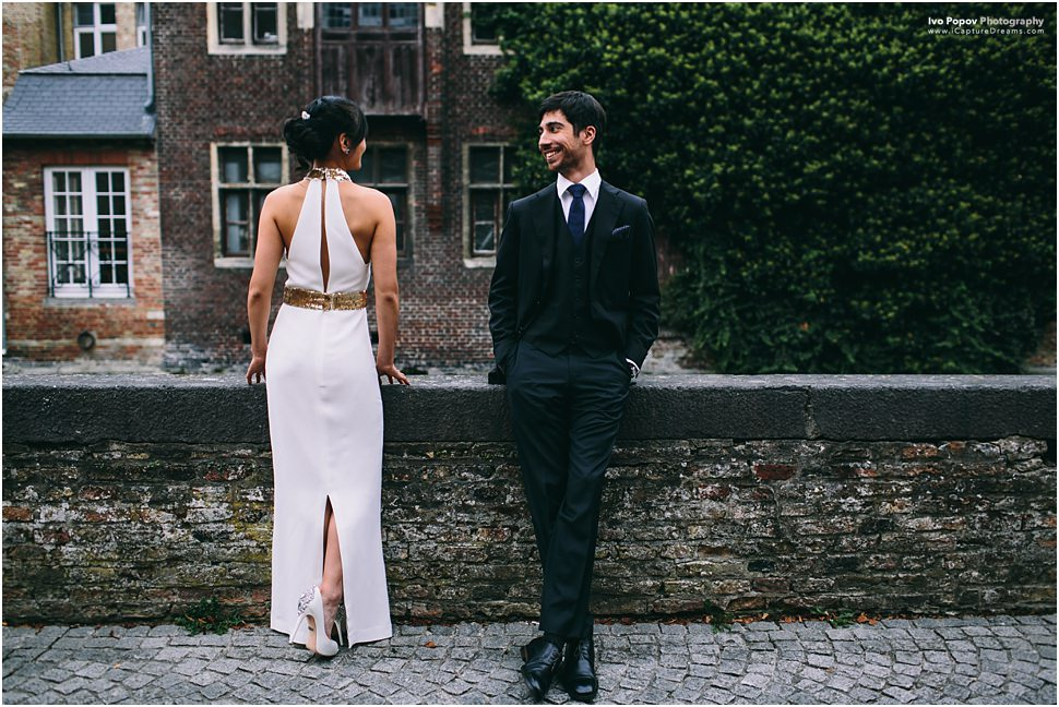 Elegant couple on a bridge in Bruges
