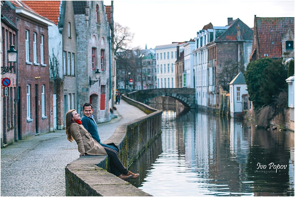 Couple having fun on a canal in Bruges