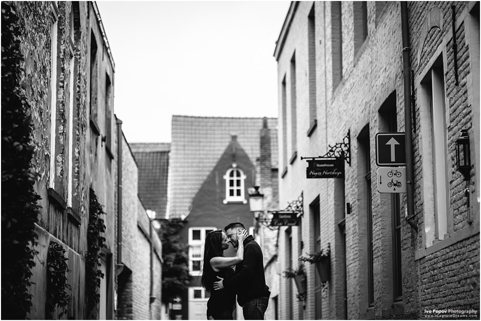 young couple in a small street in Bruges