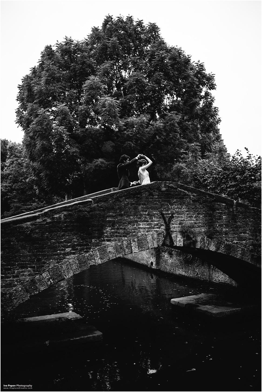 Bride and groom dancing on Bonifacius bridge in Bruges