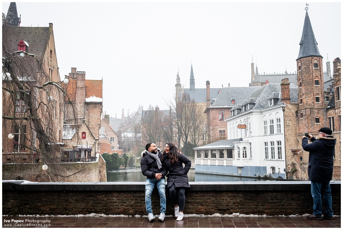 Laughing couple on a bridge in Bruges, belgium