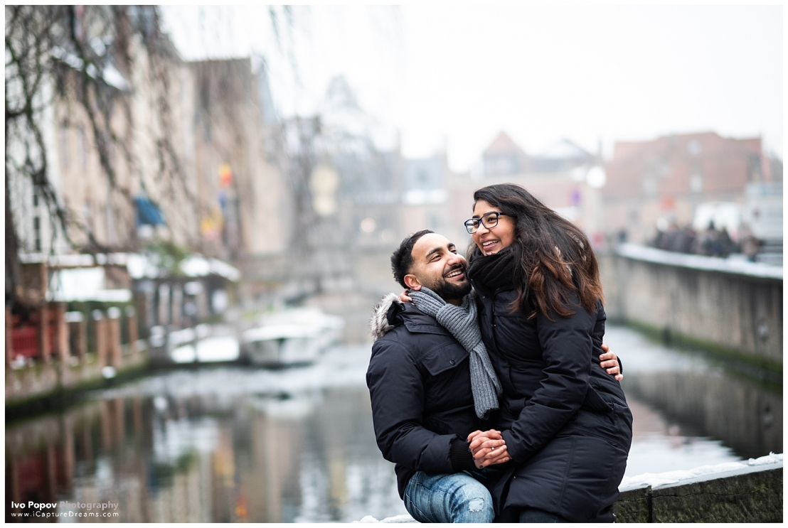 Happy engagement couple in Bruges during the winter