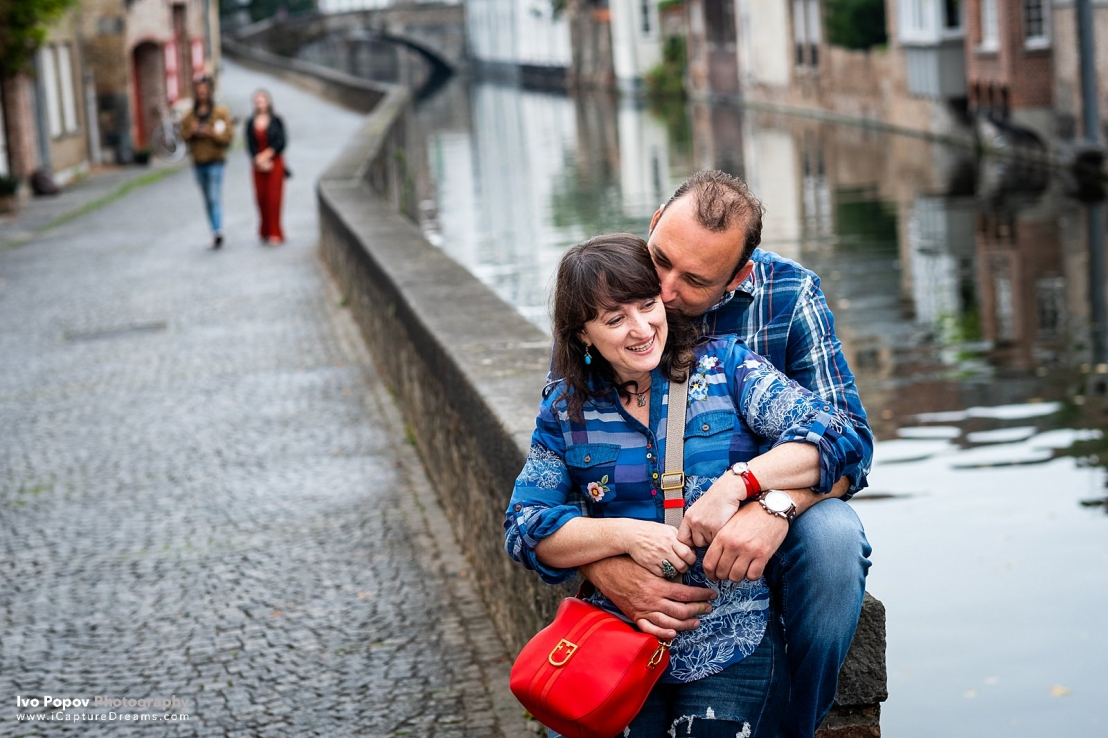 Happy couple on a bridge in Bruges