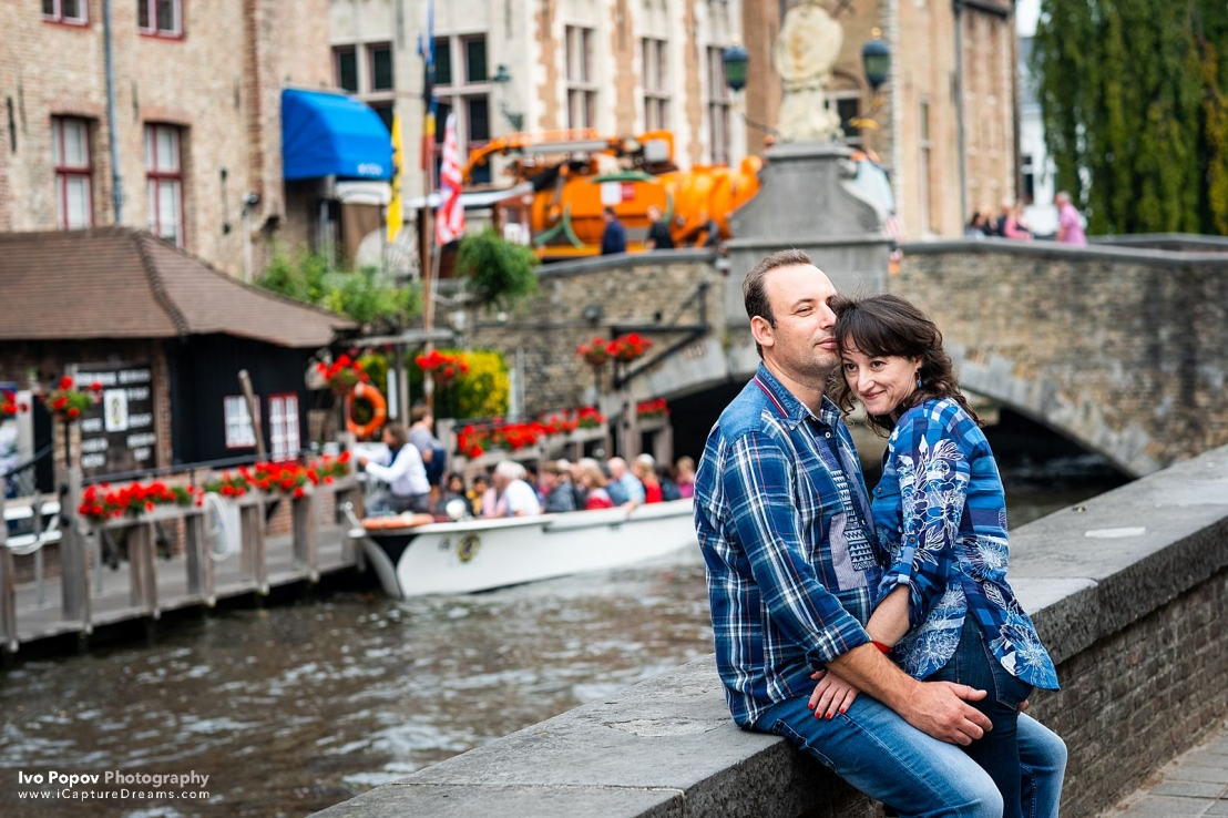 Couple in love enjoying the canals in Bruges