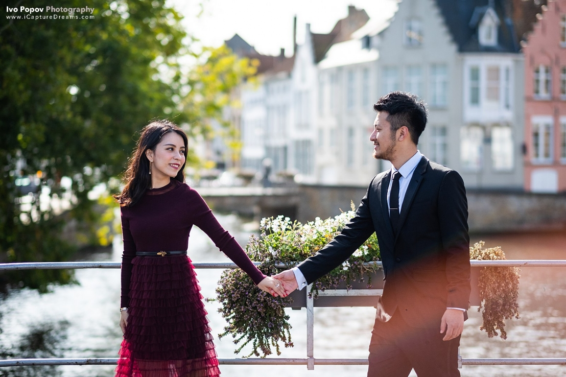 Newly engaged couple taking a walk in Bruges