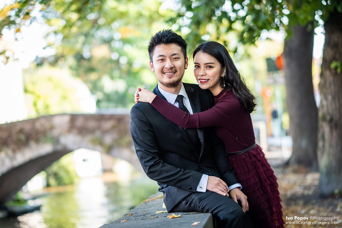 Happy newly engaged couple in Bruges
