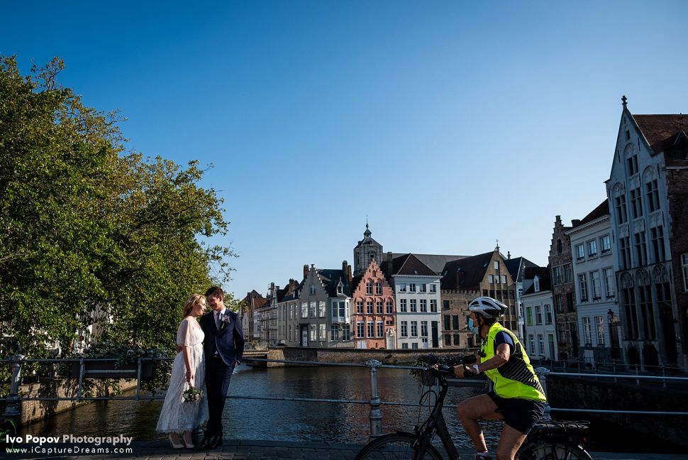 Young couple on a bridge in Bruges