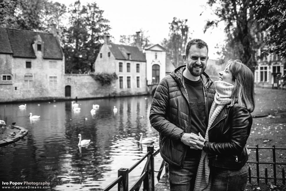 Laughing couple at the Love lake in Bruges