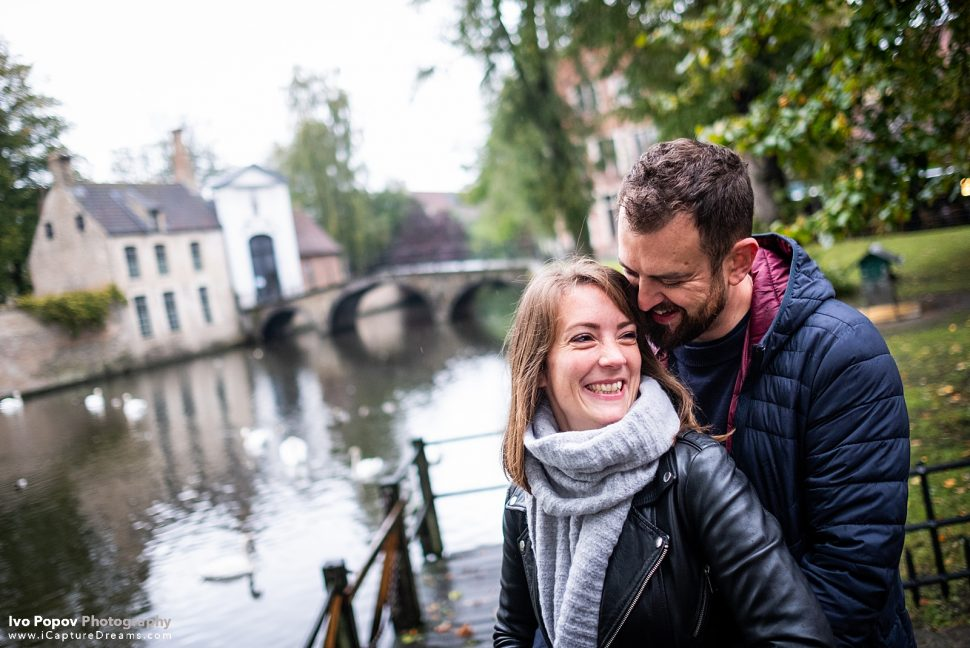 Couple smiling and laughing at the lovers lake in Bruges